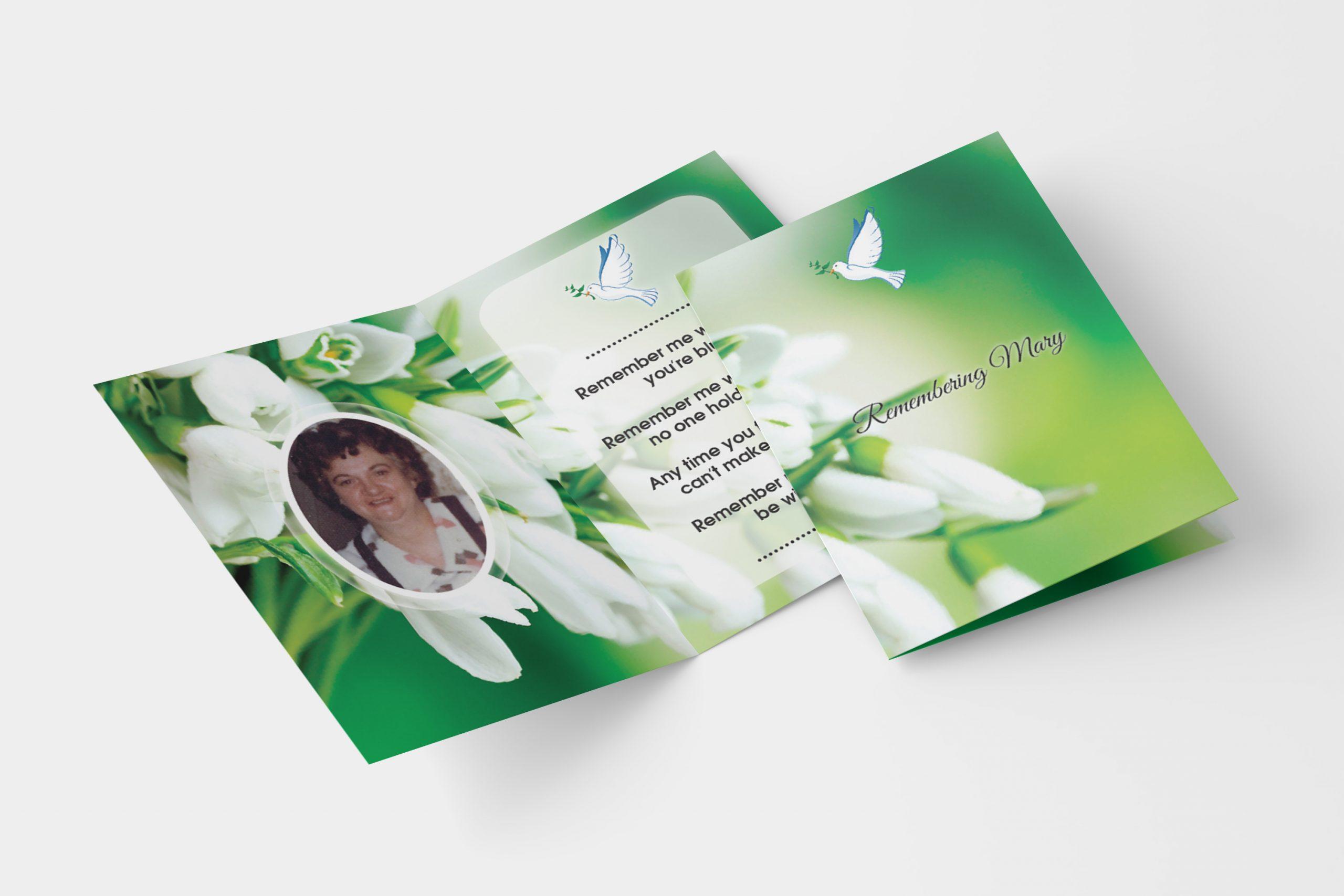 white flower folded memorial card